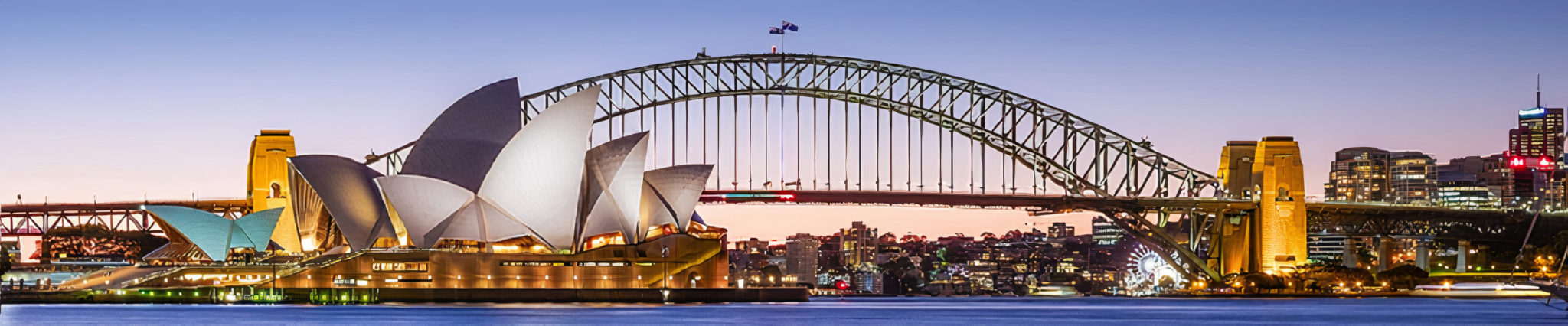 Joern Utzon's Sydney Opera House, and the Harbour Bridge, two of Sydney's most famous landmarks, taken at dusk. The Sydney Opera House is one of the most iconic buildings built in the 20th century (1973) and is UNESCO's world heritage. (Joern Utzon's